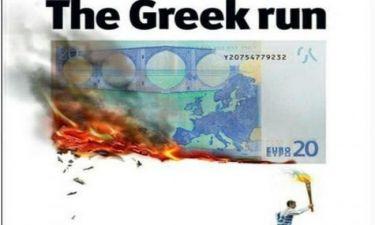 Ο Έλληνας λαμπαδηδρόμος καίει το ευρώ στο εξώφυλλο του Economist
