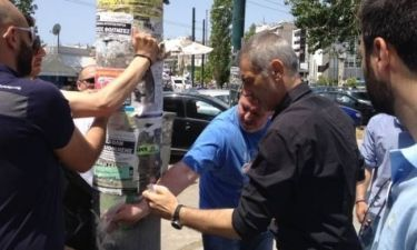 Δημοτικές εκλογές 2014: Ο Μώραλης ξηλώνει προεκλογικές αφίσες (pics)