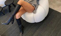 Φόρεσε μπότες μες στο κατακαλόκαιρο και πήγε στο γραφείο της! (Photos)