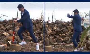 Το είδαμε κι αυτό! Ο Σάκης Ρουβάς κόβει ξύλα φορώντας... κοστούμι!